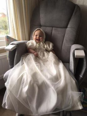 baby girl in long Christening gown