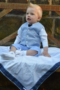 image shows tartan trimmed christening shawl