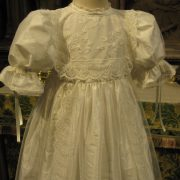 Heirloom Lace Christening Gown in church by Little Doves